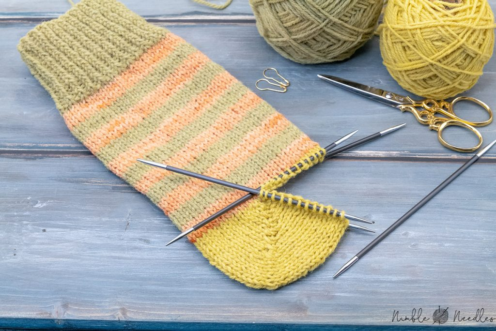 an easy german short row heel finished and lying on a wooden board