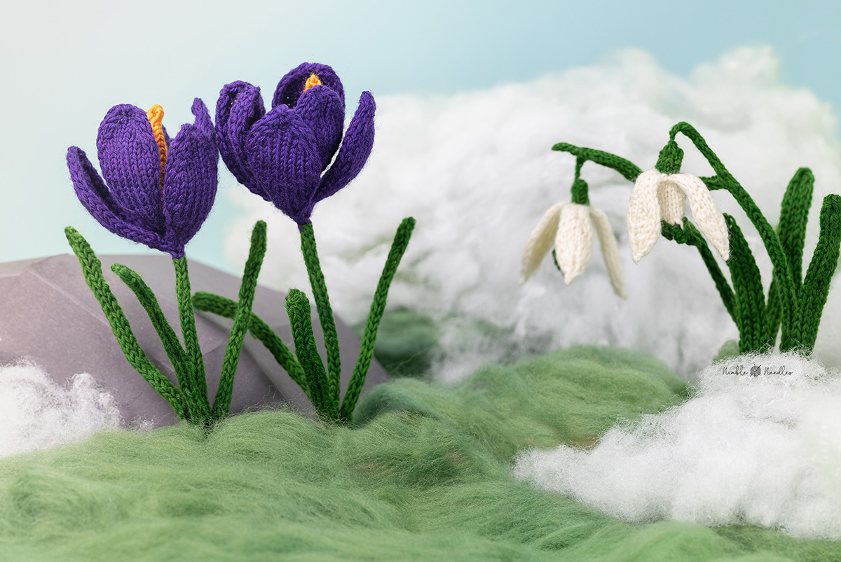 the knitted crocus deccorated in moss, and snow and there are some snowdrops on the right as well