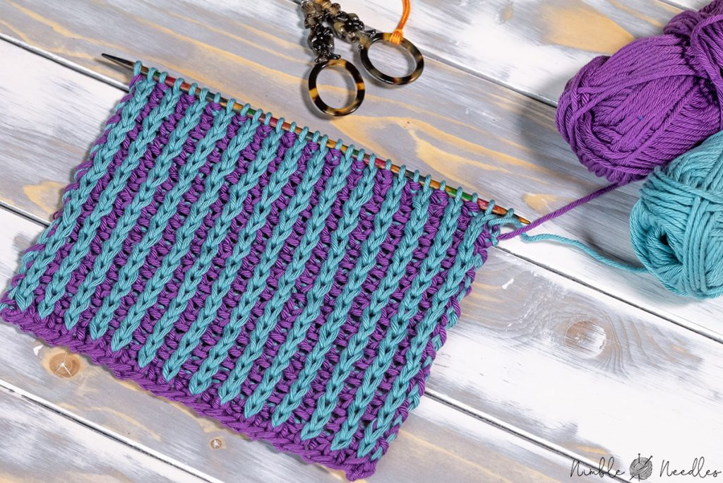 a swatch finished in the half brioche knitting stitch pattern using two colors