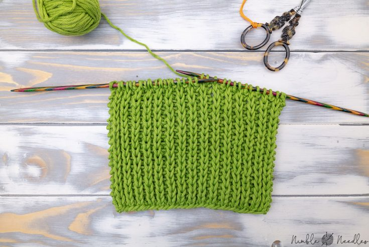 knitting the half brioche stitch with two wooden needles