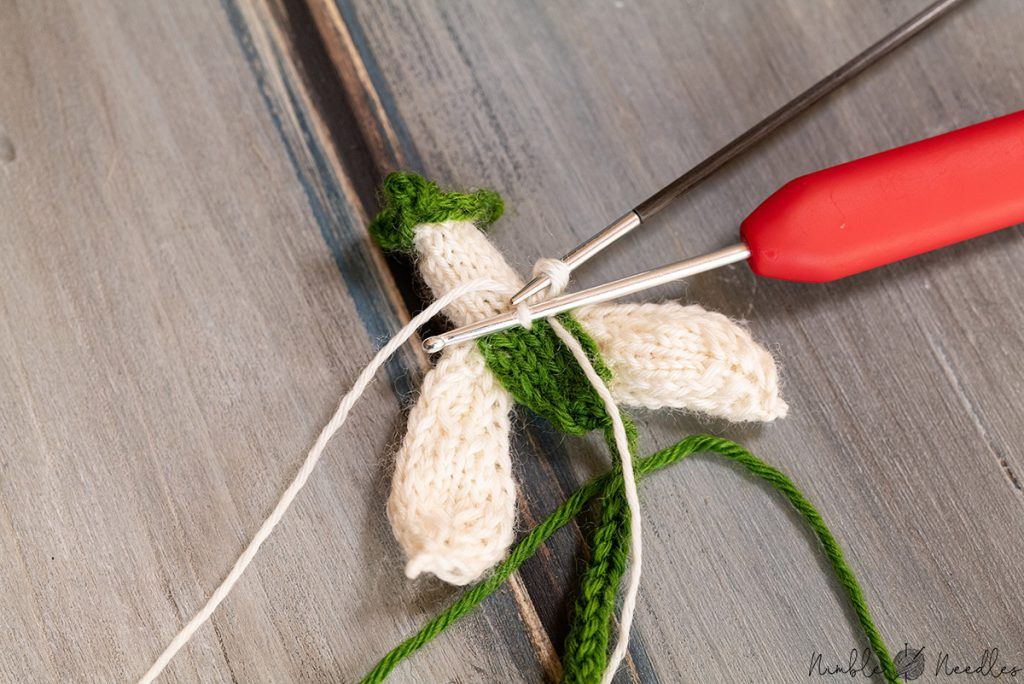 picking up stitches for the petals of the knitted snowdrops using a crochet hook