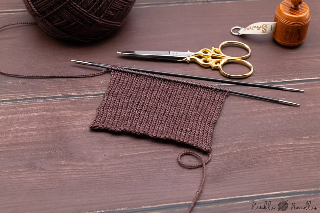 knitting the swatch to figure out your gauge and thereby the size for the socks