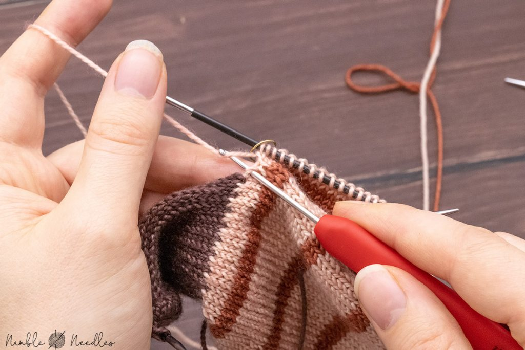 picking up one stitch from the gap to prevent holes around the gusset of your sock