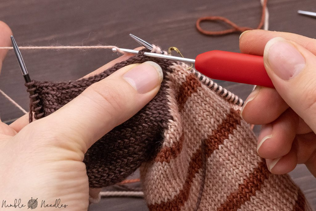 picking up a stitch with a crochet hook from the heel flap