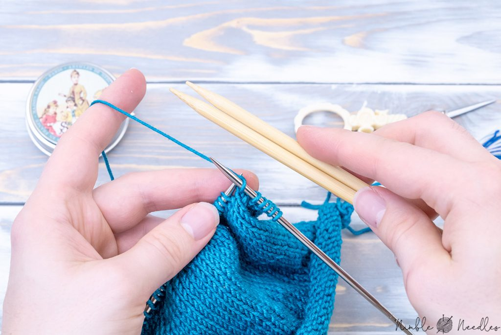 comparing wooden needles with metal needles to knit faster