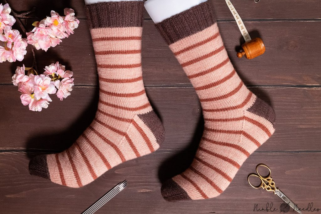 the finished product of my how to knit socks video modeled on feet