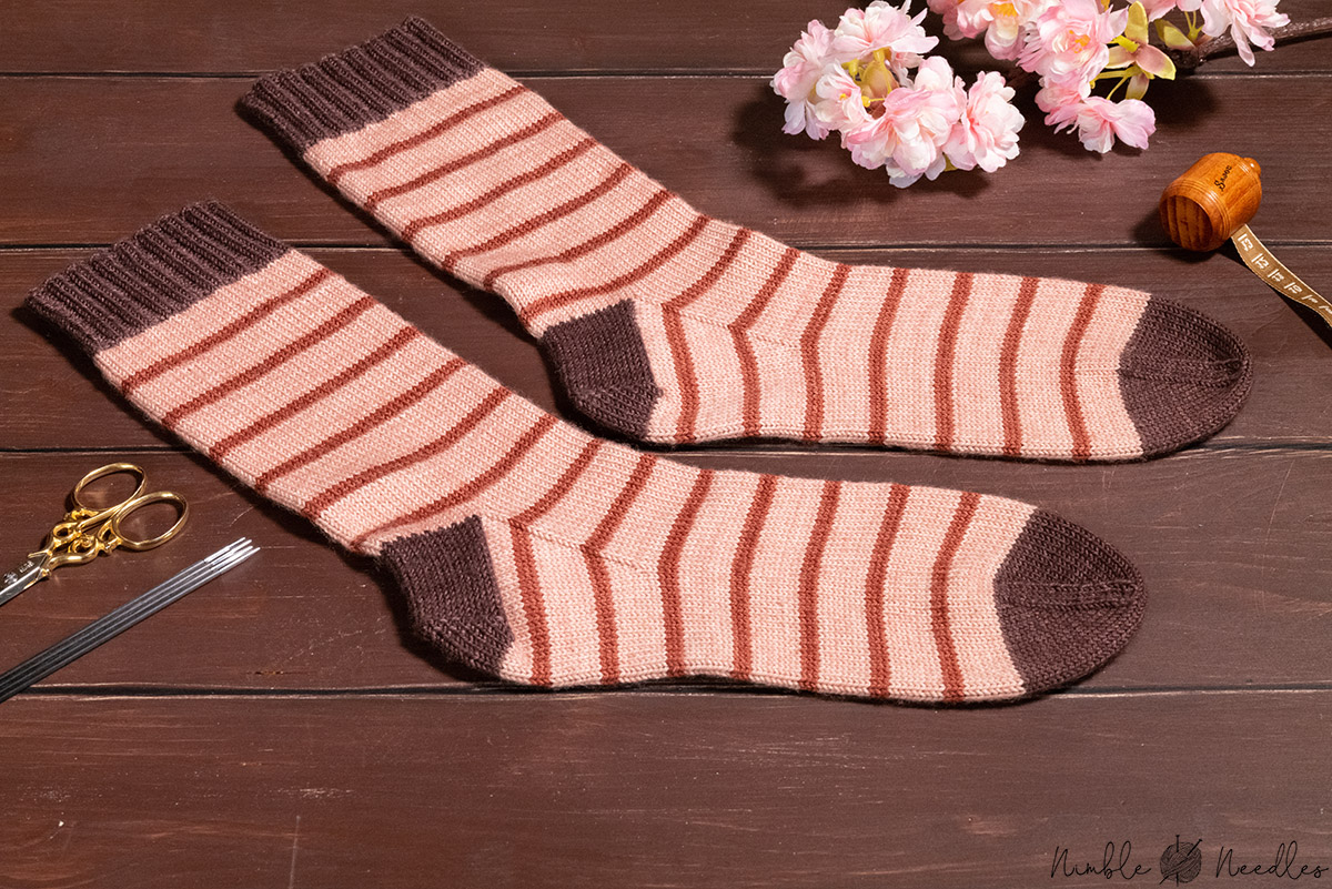 the finished socks on a wooden board - close-up shot