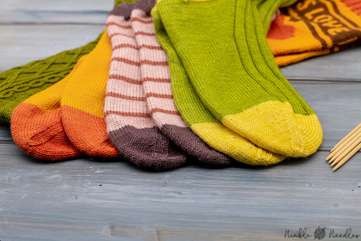 toes of different socks lined up next to each other
