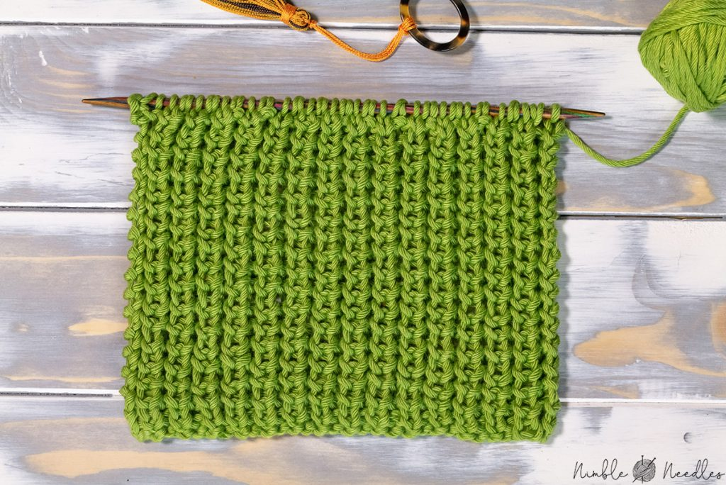 a swatch showing wrong side of the half brioche knitting stitch pattern