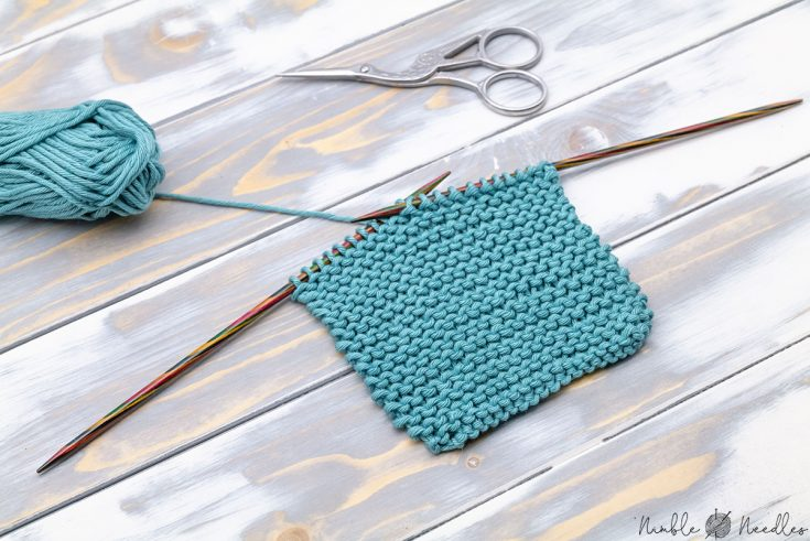 a swatch in reverse garter stitch from above on a wooden board