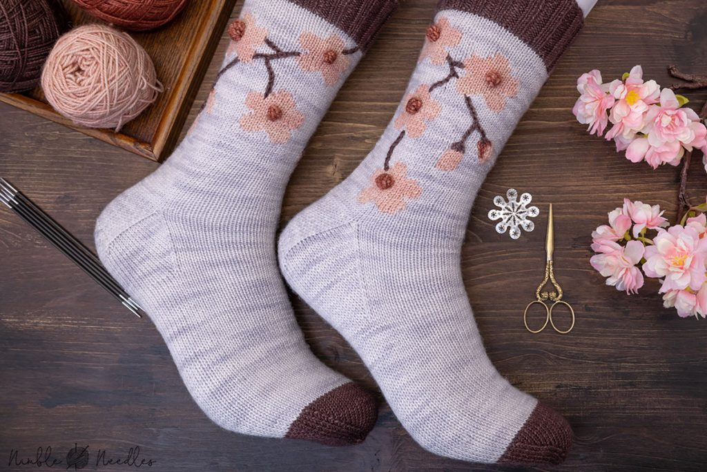 cherry blossom socks modeled on manequin feet