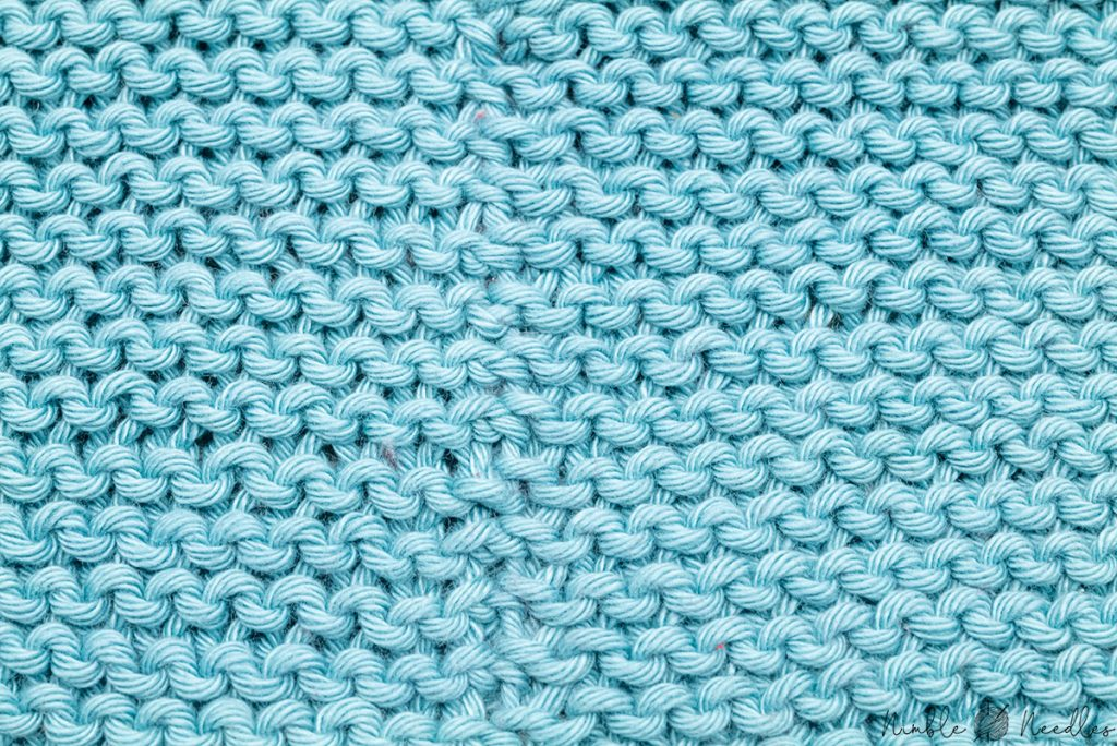close up of the finished seam using the mattress stitch for garter stitch in the same color