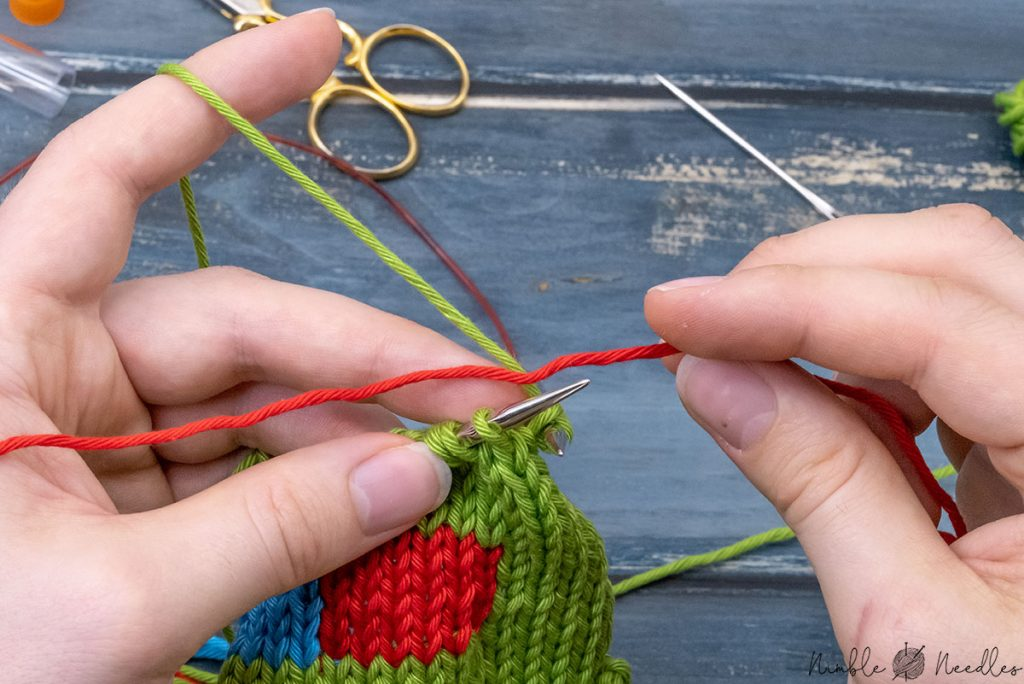 placing the new color between needle and working yarn one stitch before you need to start with a new color
