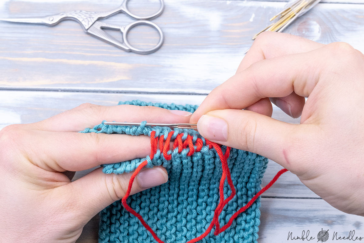 holding the two parts you want to sew together between three fingers to make the seaming easier