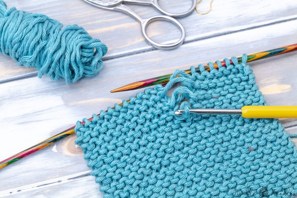 fixing a dropped stitch in garter stitch with a crochet hook several rows down