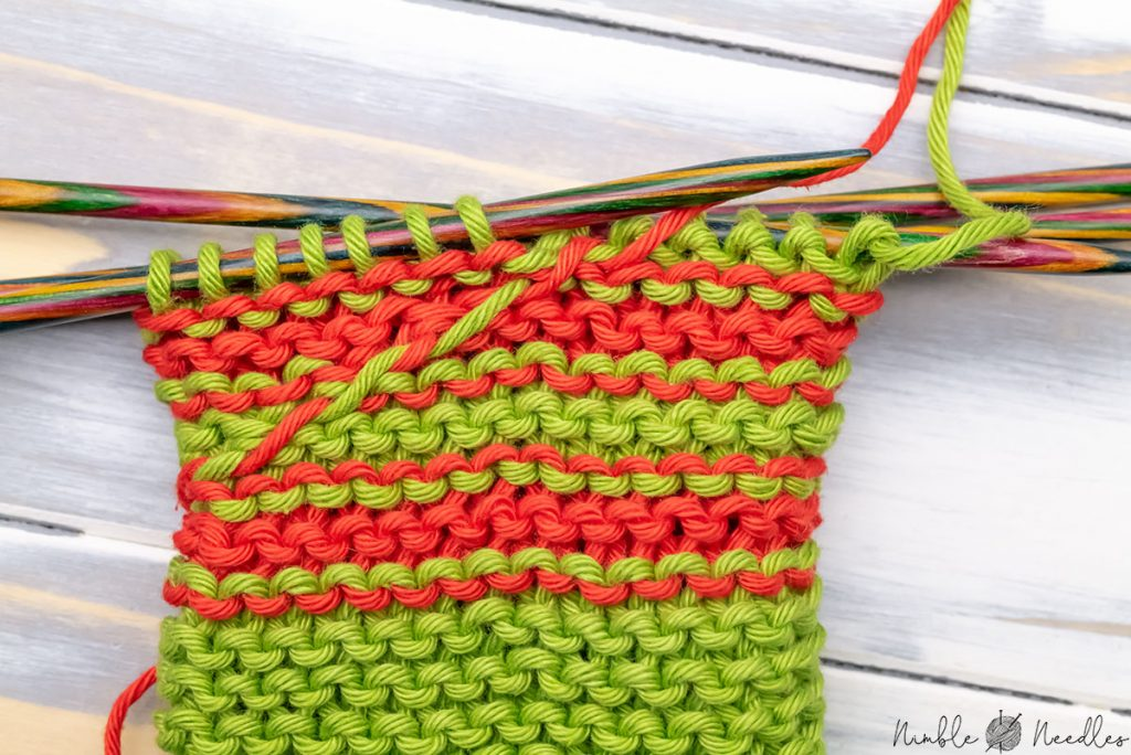 the very visible floats on the wrong side when knitting garter stitch stripes in the round