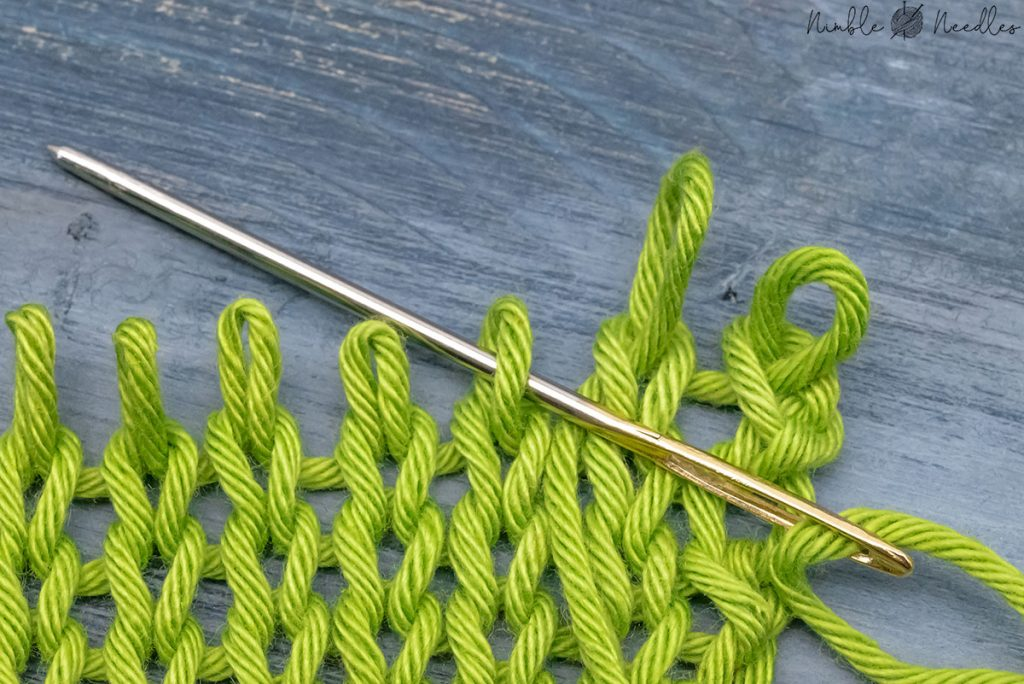 going into stitch from behind to graft a knit stitch