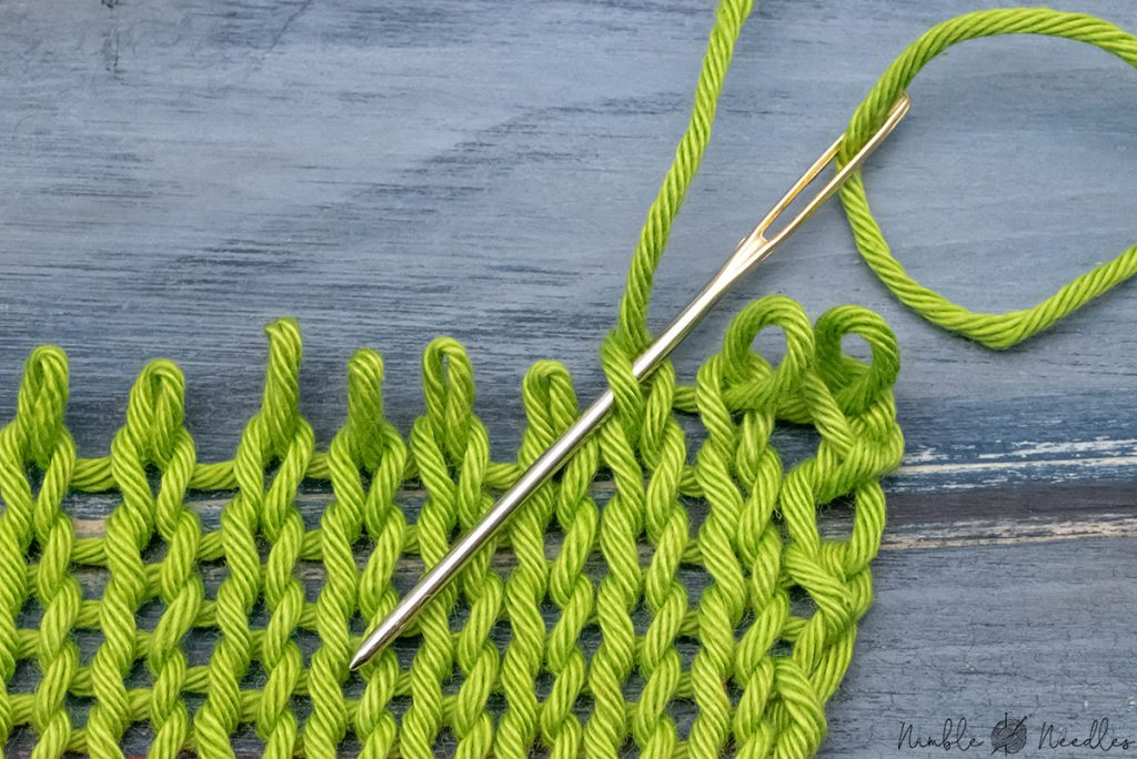 going into the front to finish grafting the knit stitch