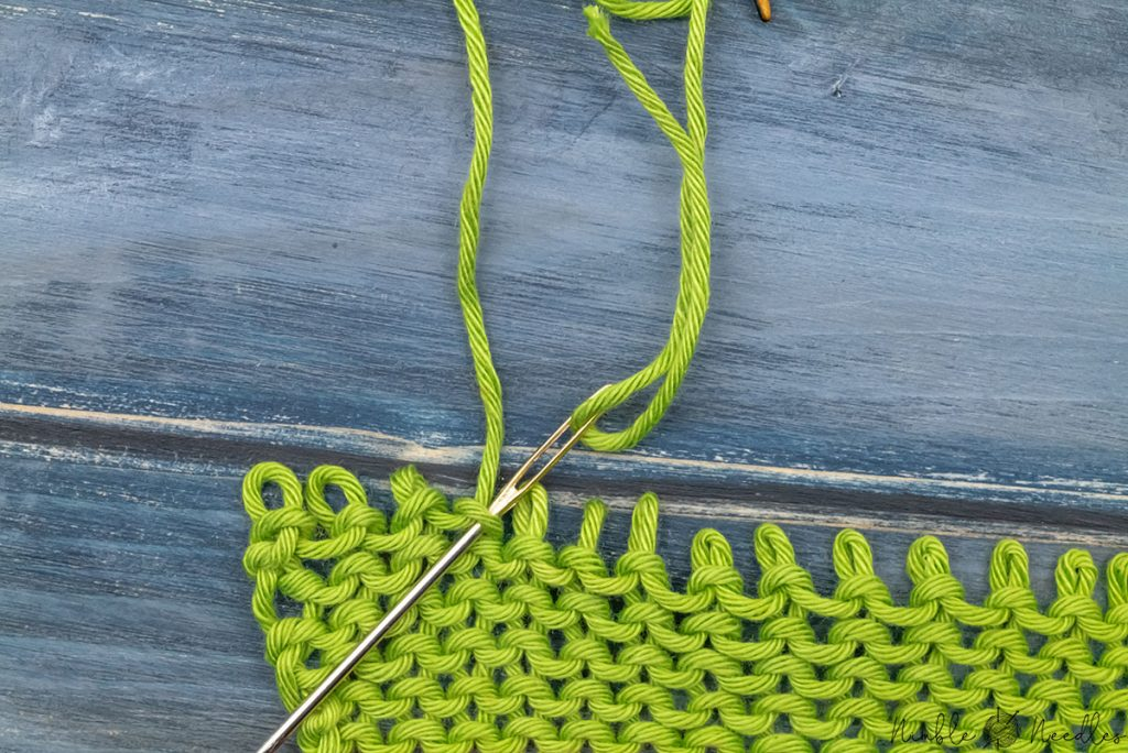 going into the stitch from behind to finish the purl graft