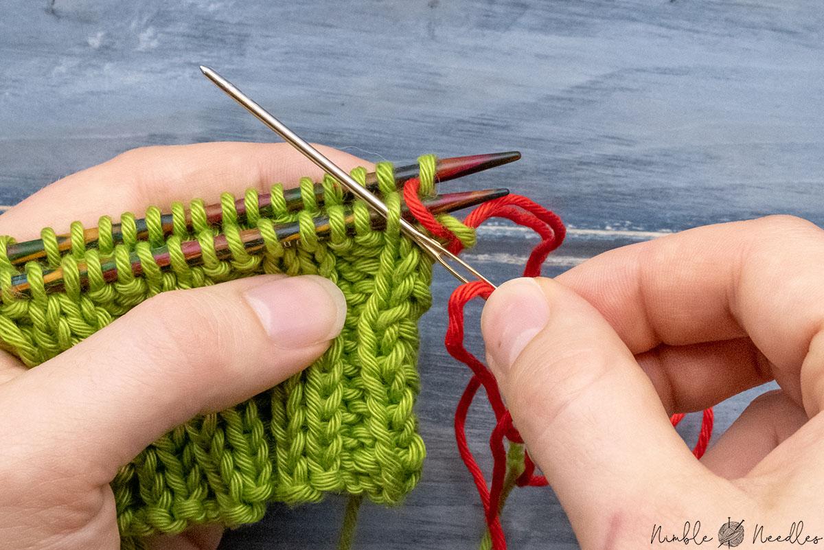going through the adjacent stitch purlwise