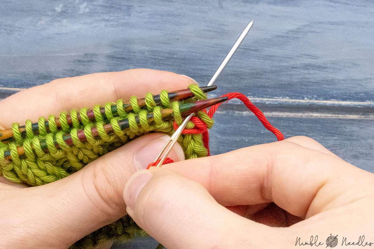 Going through the adjacent stitch knitwise