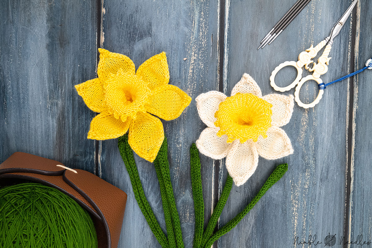 the finished knitted daffodil flowers on a wooden board