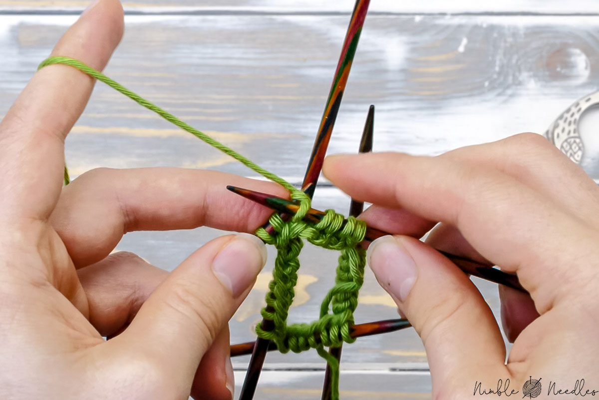 someone knitting row 1 of garter stitch in the round