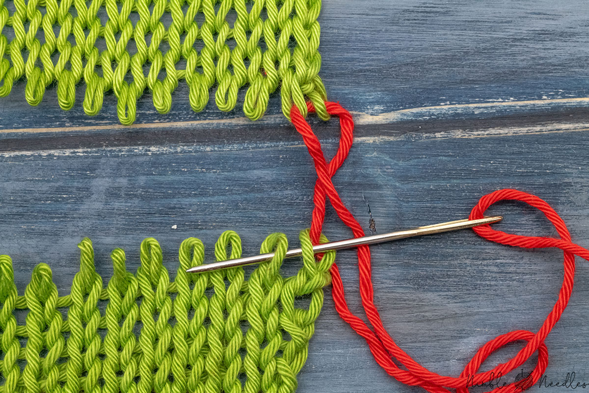 going through the first two loops on the bottom part at the same time to make grafting knitting faster