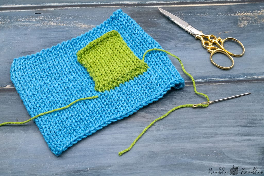 two knitted pieces grafted together in the middle of a project to form a pocket