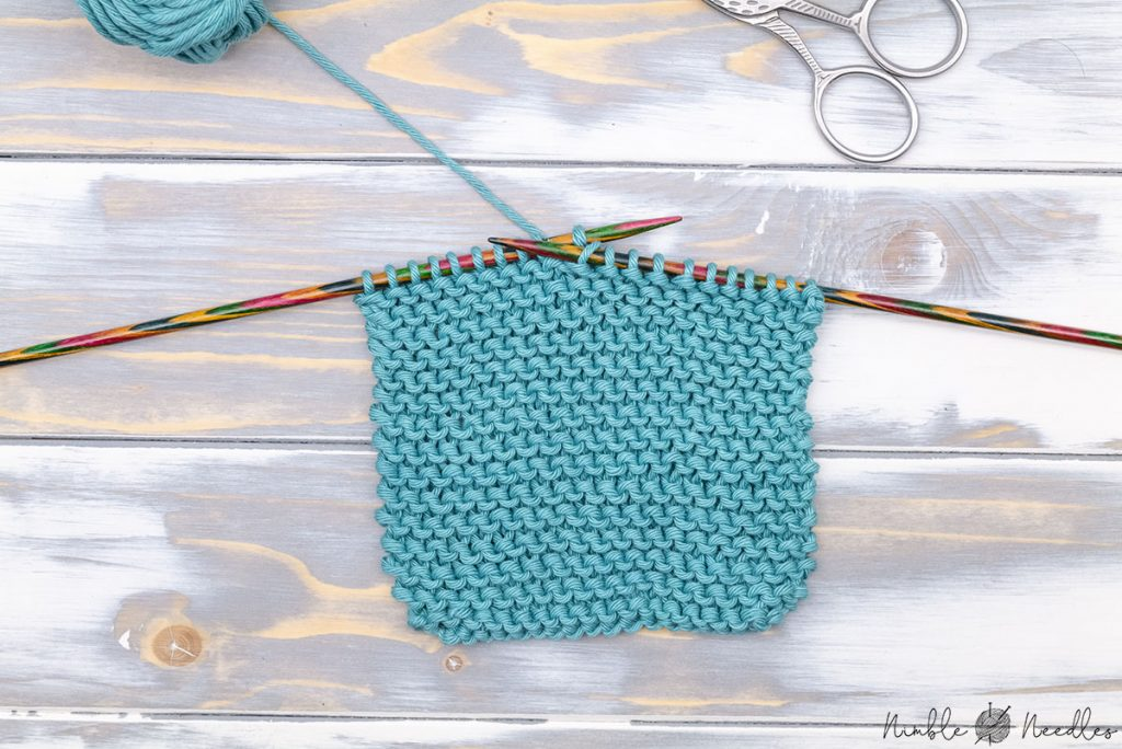 View of a swatch in reverse garter stitch on the knitting needles