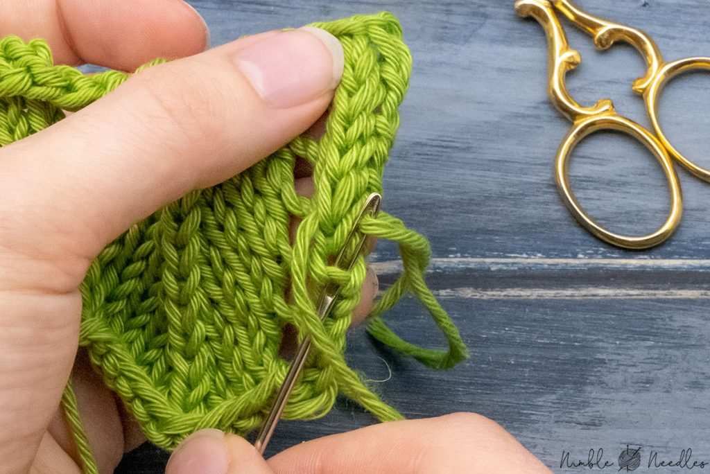 going underneath the rib between two knit stitches one more time