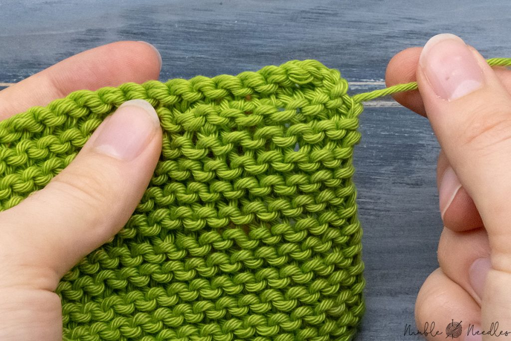 how the garter stitch swatch looks like after you wove in the ends