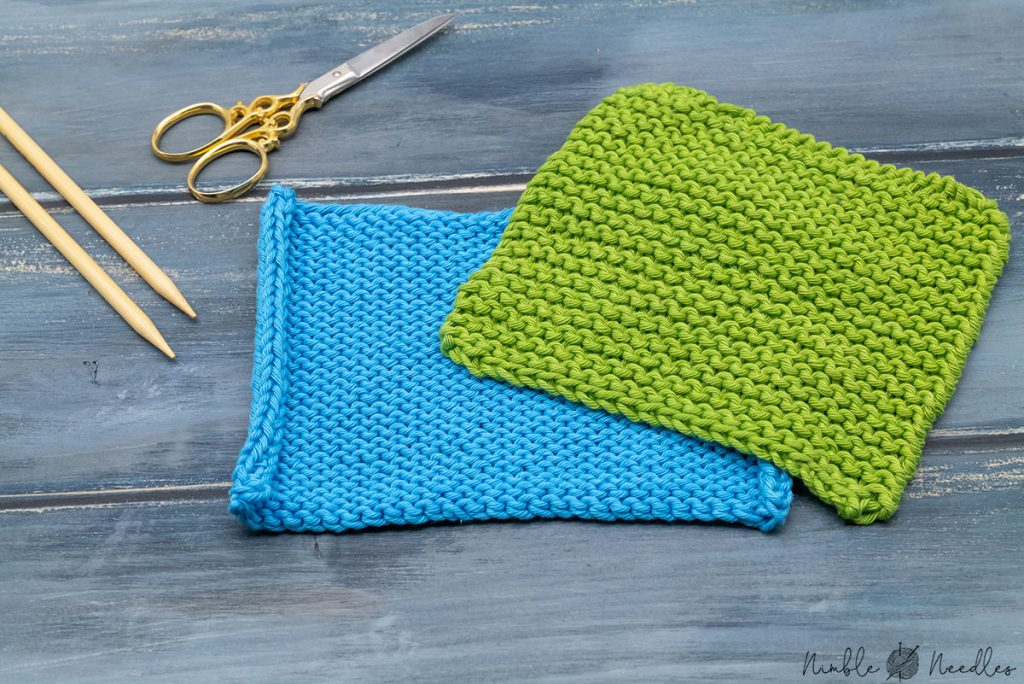 2 swatches in reverse stockinette stitch and garter stitch next to each other with some knitting needles in the background