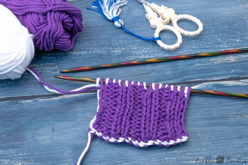 a swatch in one colored double knitting 2x2 rib stitch