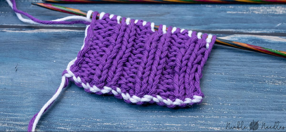 a close-up of a swatch knitted in a double knitting rib stitch in one color