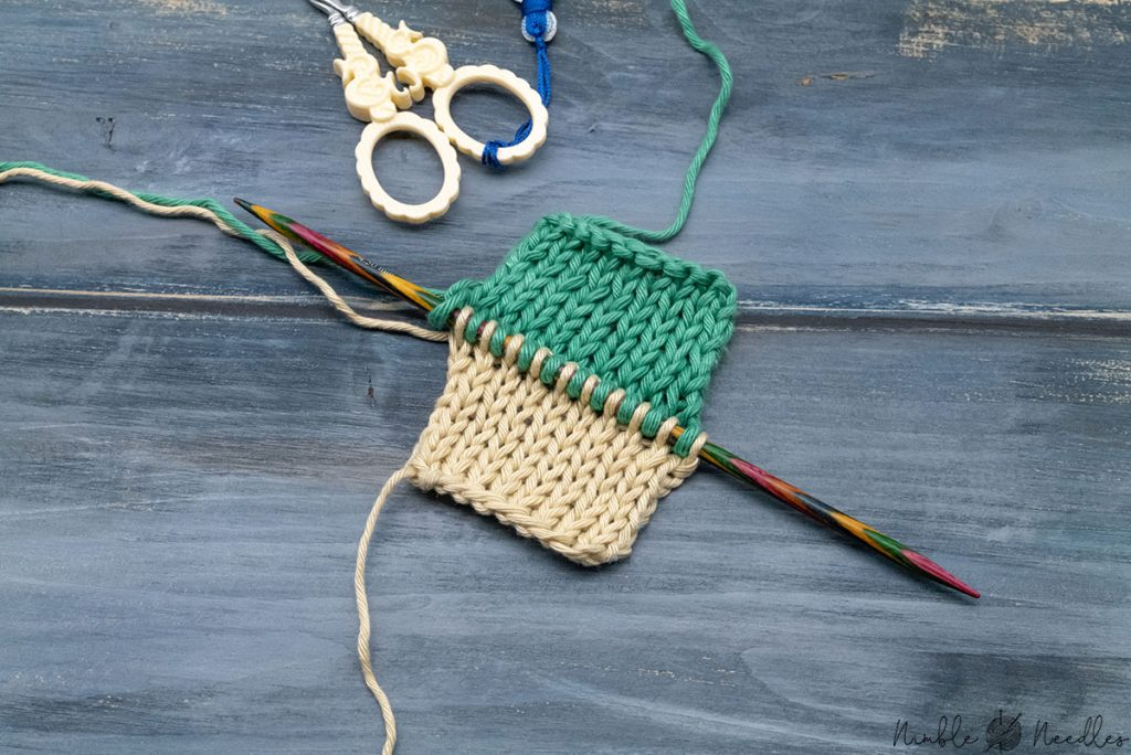 knitting two at a time with one knitting needle using a special cast on method that keeps the pieces separate
