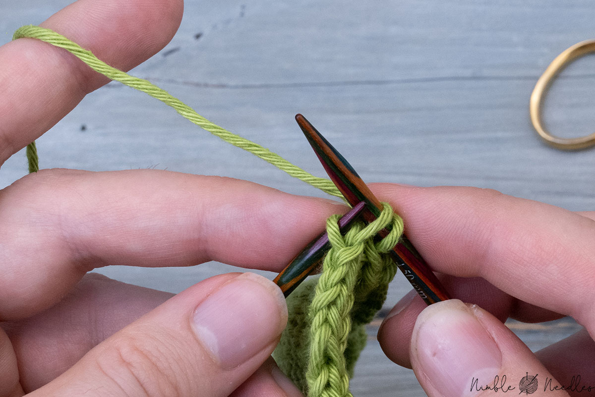 lifting the left loop of the stitch one row below on your knitting needle