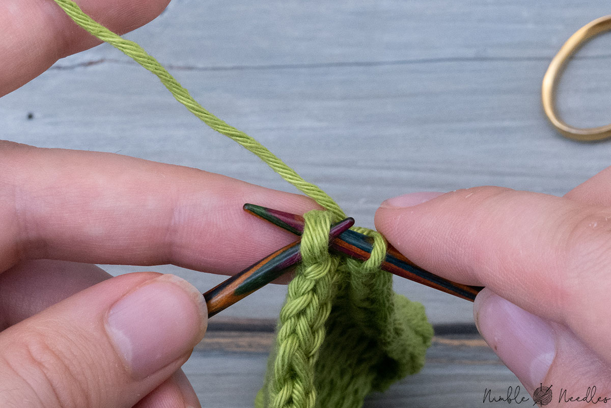 slipping the two stitches back to the left needle