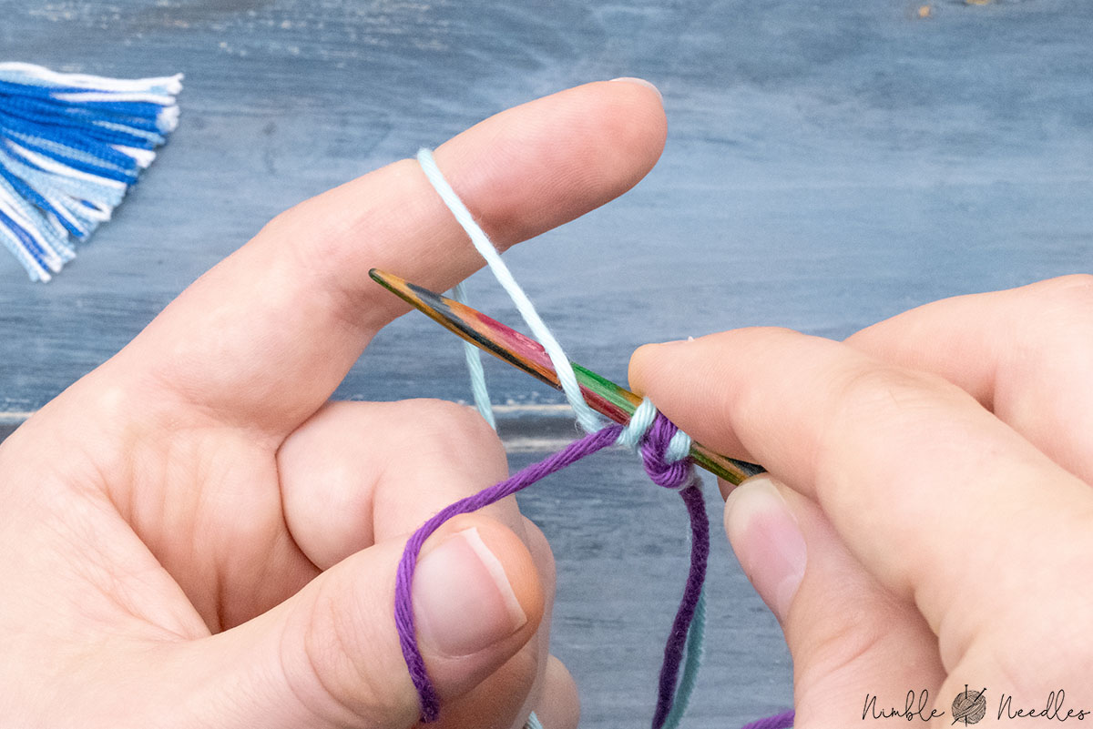 going around the yarn towards the index finger from above and behind