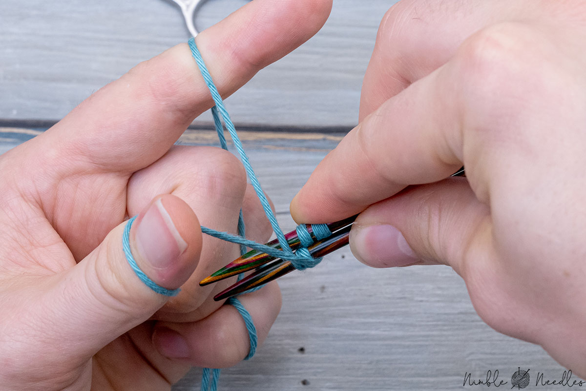 twisting the needle around by 360 degrees by going behind and below the yarn