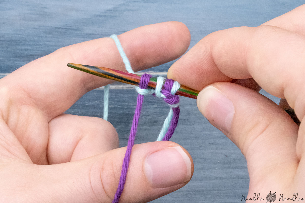tightening up the second stitch by spreading the fingers