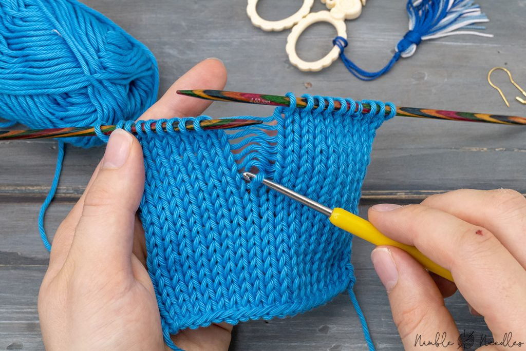 fixing a dropped stitch with a crochet hook