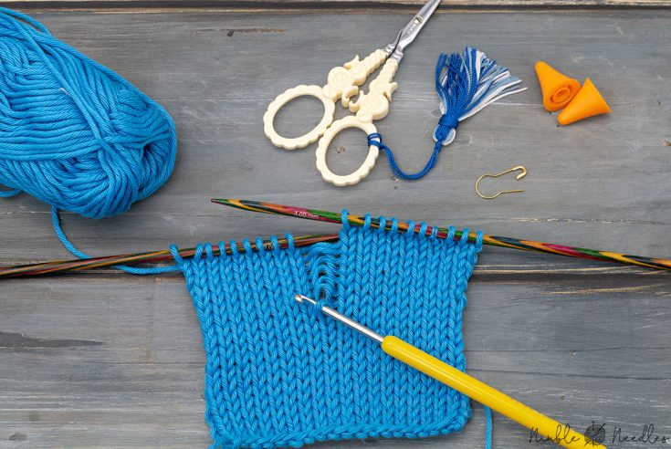 fixing a dropped stitch with a crochet hook in knitting