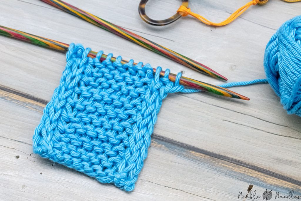 a knitted swatch with an icord edge