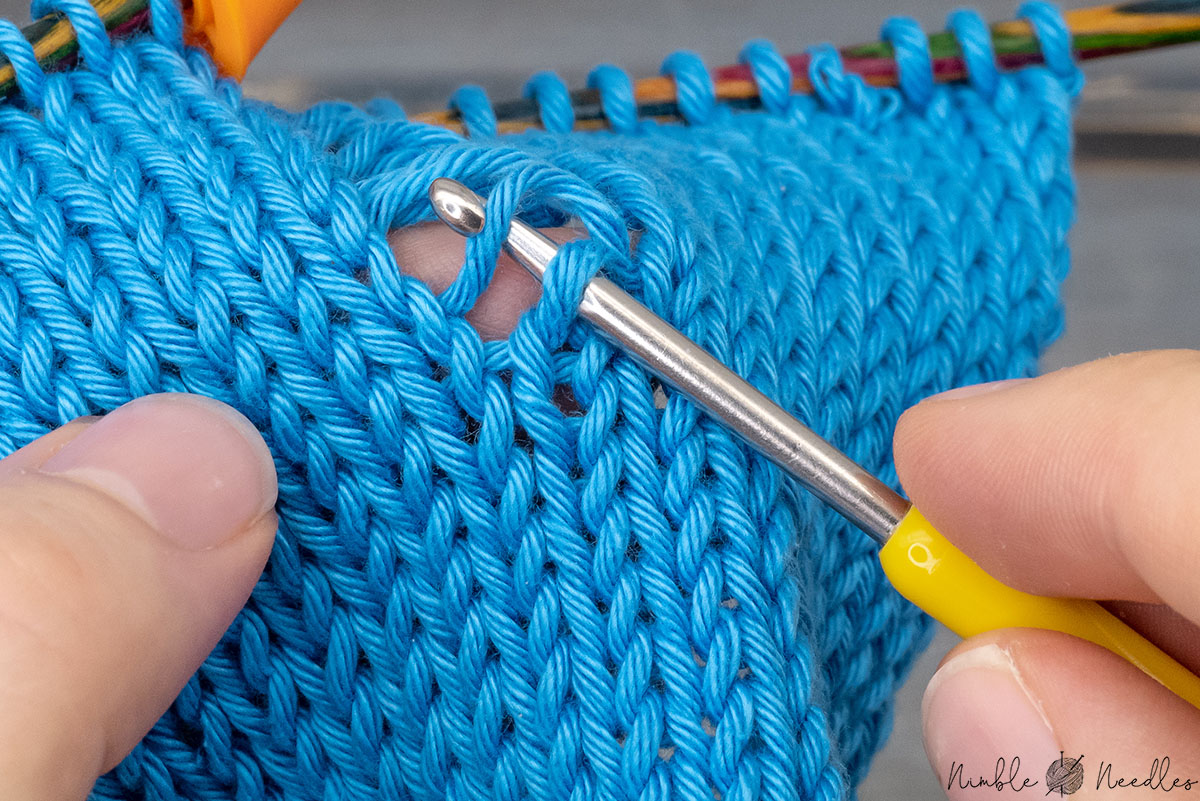 pulling the first strand through with the crochet hook