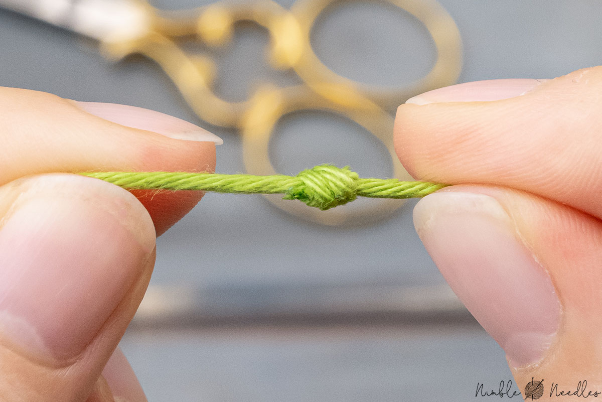 close-up of a finished magic knot in knitting