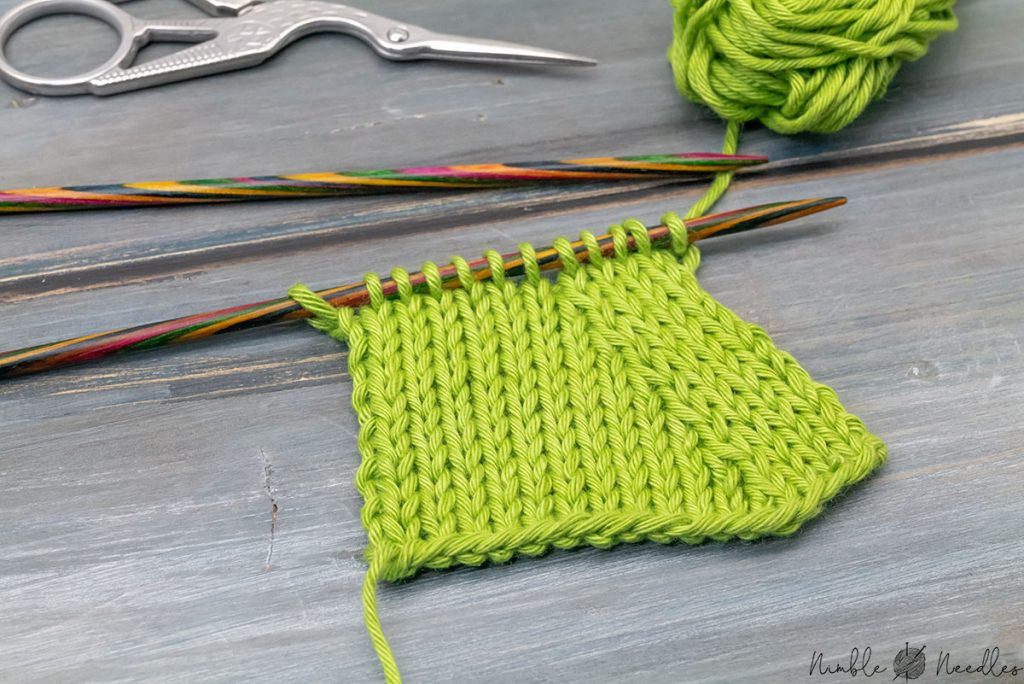 a knitted swatch decreased with k2tog left seen from an angle so you can see the neat line