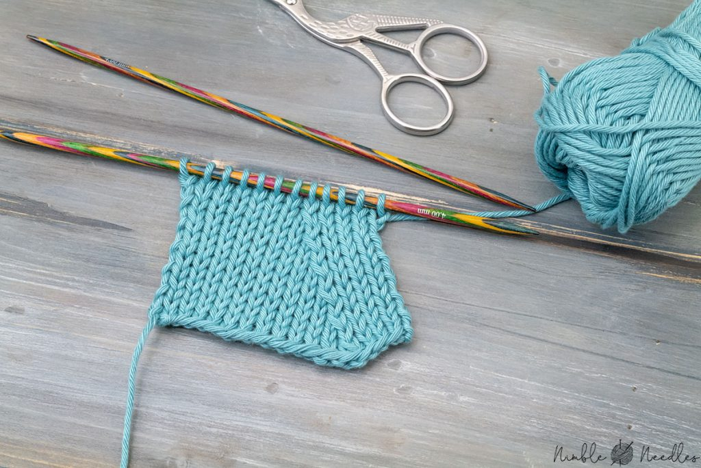 a knitted swatch decreased with skp - a neat left-leaning decrease