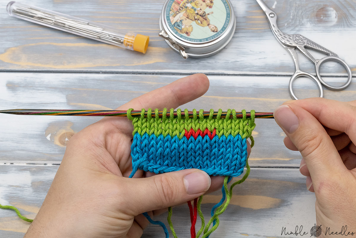 a knitted swatch where someone changed color with twist and weave