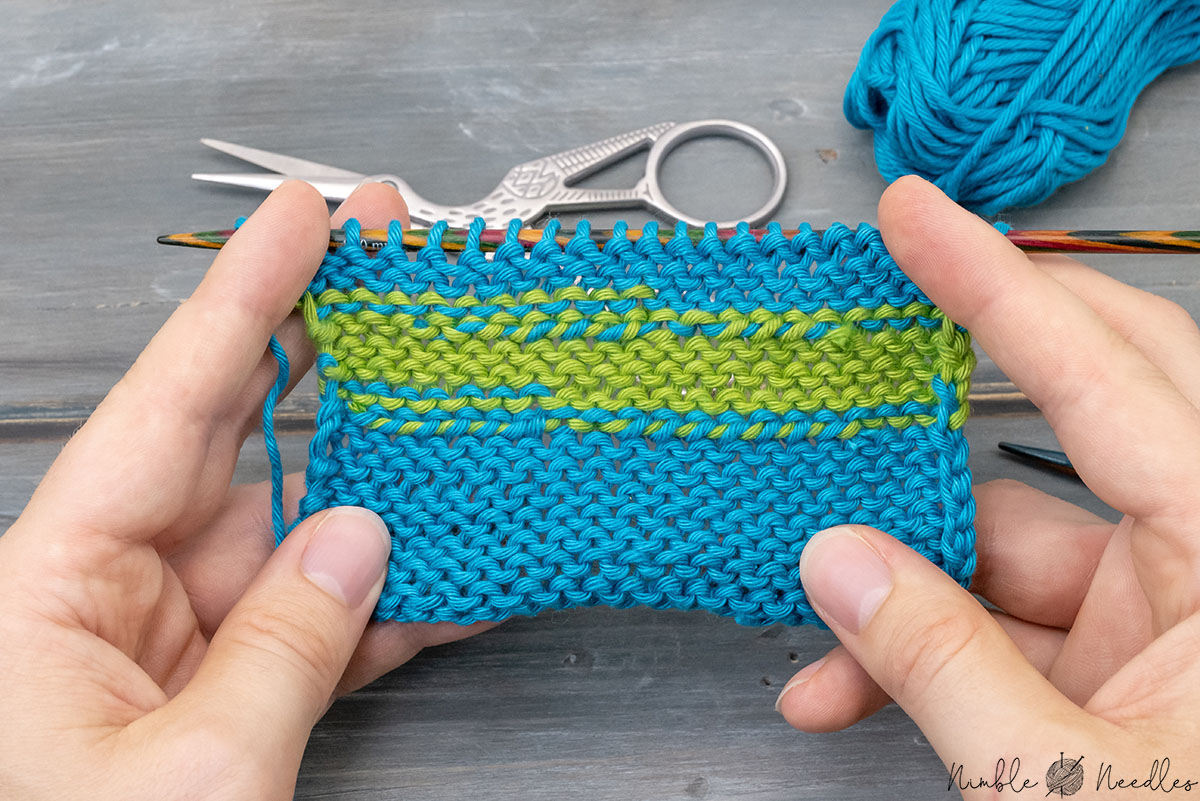 a swatch where someone did a weave in as you knit seen from the backside with visible lines